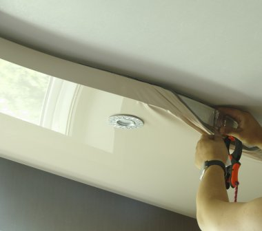 Master repairs stretch ceiling