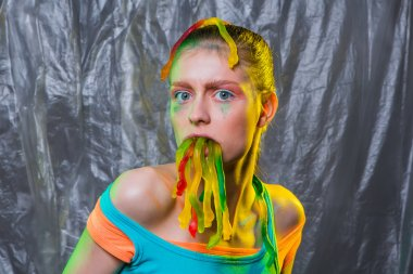 Young woman with gummy jelly worms candies