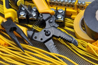 Pliers strippers with electrical component