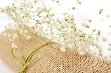 Bouquet flowers on linen