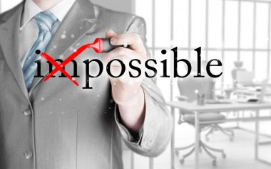 Businessman Hand turning the word Impossible into Possible with red marker stock vector
