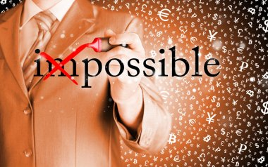 Businessman turning Impossible into Possible