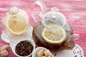 Lemon tea in glass teapot