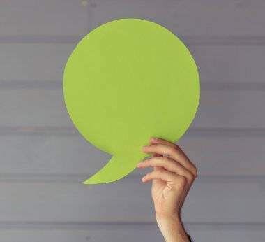 Hand with speech bubble