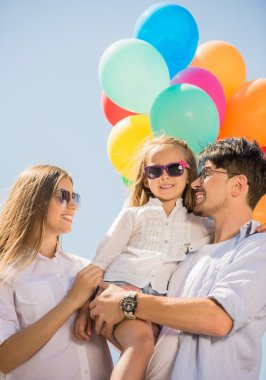 Family with balloons outdoors