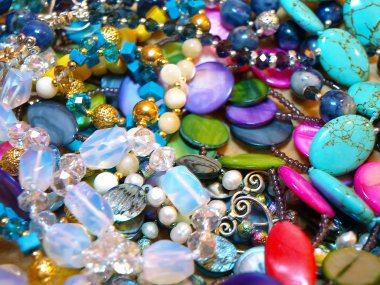 Scattering beads of semiprecious stones