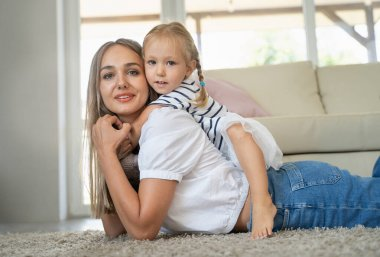 mom and daughter play at home