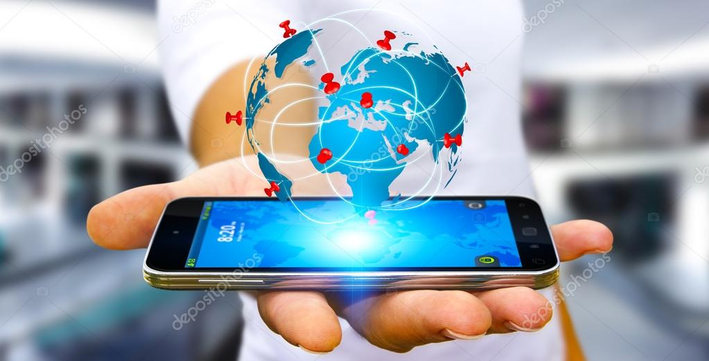 Businessman holding digital world map in his hands stock photo businessman with digital world map and pins floating over his mobile phone photo by sdecoret gumiabroncs Images