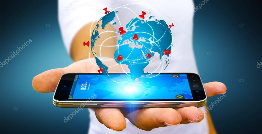 Businessman holding digital world map in his hands stock photo businessman with digital world map and pins floating over his mobile phone photo by sdecoret gumiabroncs Choice Image