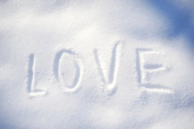 Text LOVE on the snow