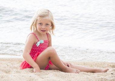 Little Girl Sunbathing on the Beach