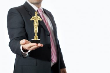 Man in office with oscar