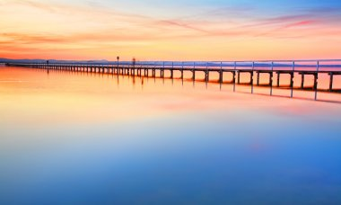 Magnificent colours in the sky, pink towards the north and red towards the south, at  idyllic Long Jetty Central Coast, Australia stock vector