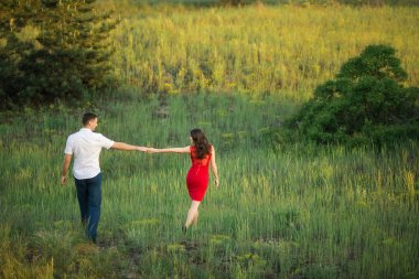 Young couple walks in park