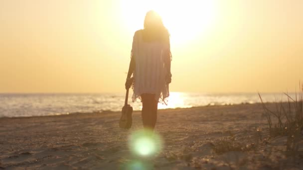 Silhouette of the Woman with Ukulele on the Beach Summer Vacation