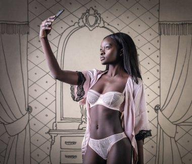 Woman taking a selfie in lingerie
