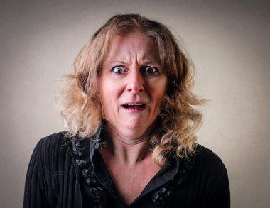 Portrait of horrified woman