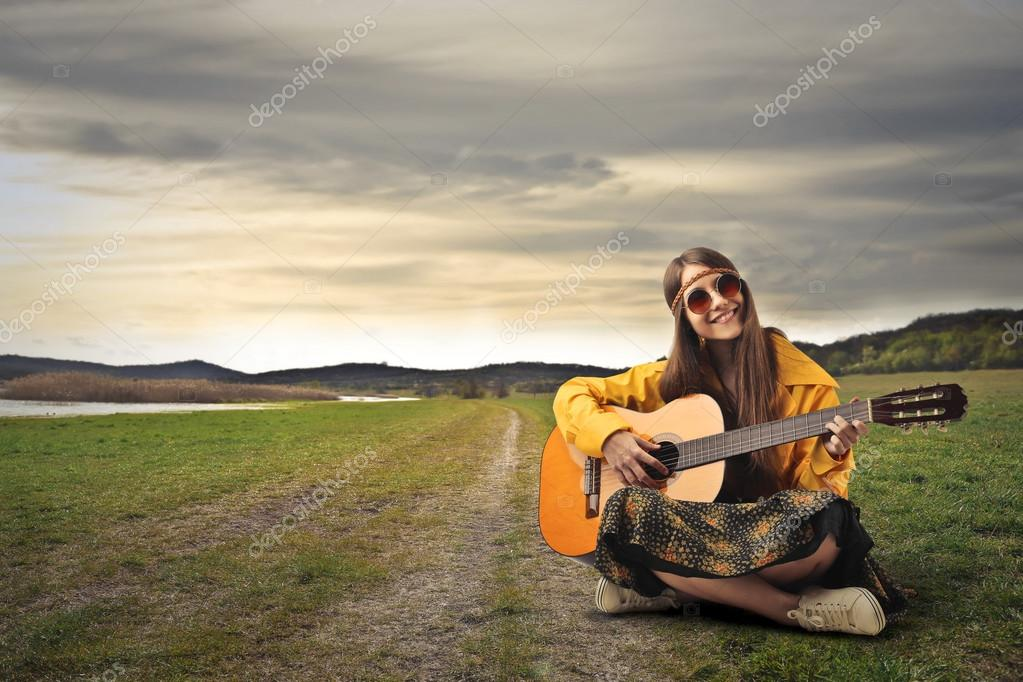 Hippy teenager with guitar