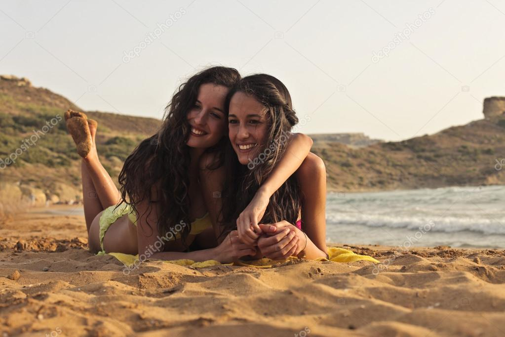Two friends together at the seaside