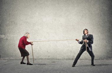 Grandmother and businessman making a fight with a rope stock vector
