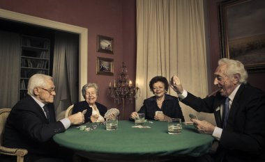 Group of elderly people playing cards