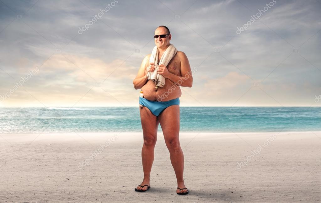 Chubby man at the seaside