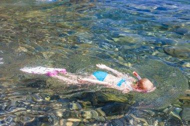 Little girl snorkeling in Mediterranean Sea stock vector