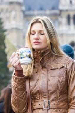Woman drinking hot wine at Christmas market