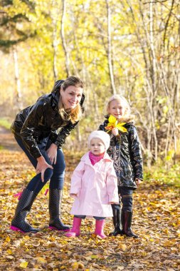 Mother with her daughters in nature