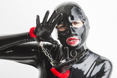 woman wearing latex clothes with handcuffs