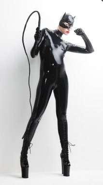 woman wearing latex clothes with a whip