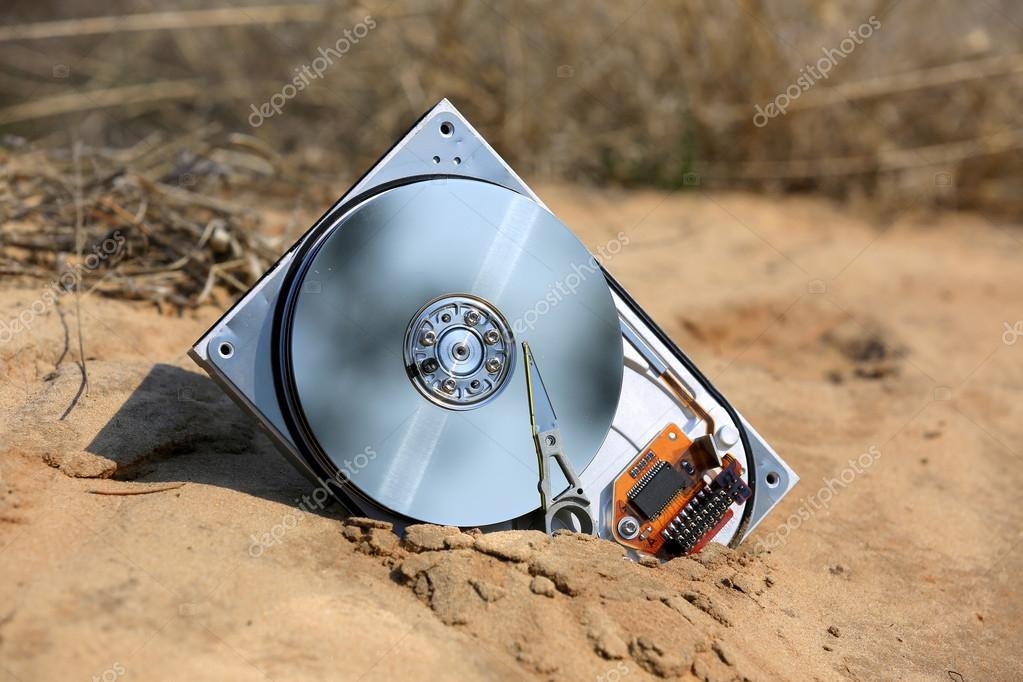 Broken hard drive in sands