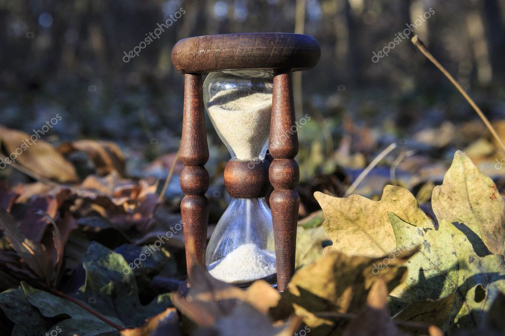 hourglass in autumn forest