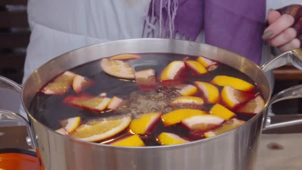 Crop woman brewing mulled wine