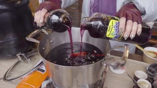 Crop woman cooking nonalcoholic mulled wine in cafe