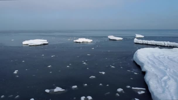 Ice pieces floating on cold seawater