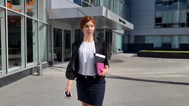 Young business woman walking to the office early in the morning