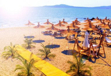 Straw umbrellas on beautiful sunny beach in Bulgaria resort stock vector