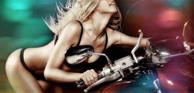 Sexy blond girl on motorcycle