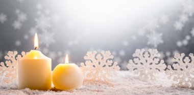 Burning candles on snow