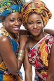 Dva modely africké móda na bílém pozadí.