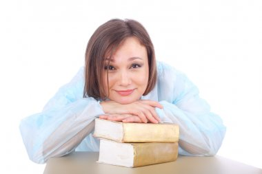 young female doctor with books