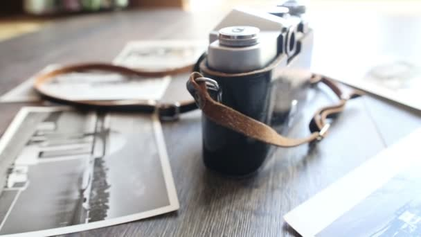 Old camera on a wooden table
