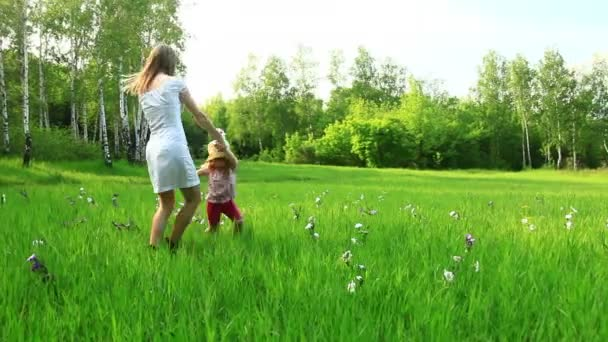 Mother and child dancing in the field