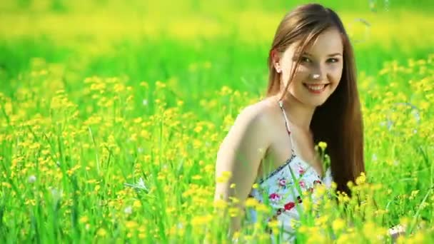 Young woman in the yellow meadow