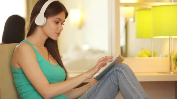 Teenager with tablet listening to music.