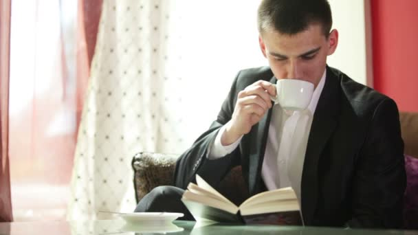 Man reading and drinking