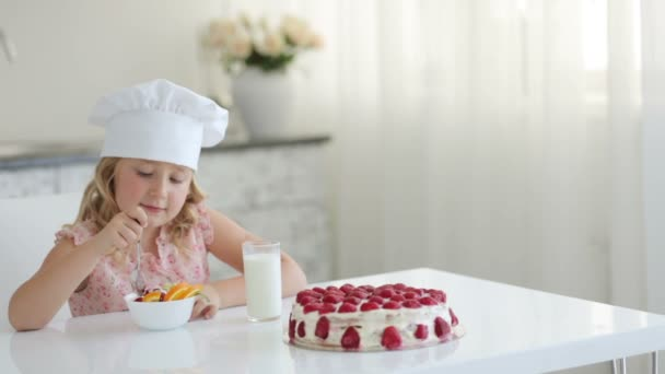 Little girl eats yogurt