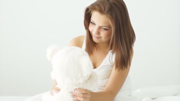 woman cuddling with teddy bear