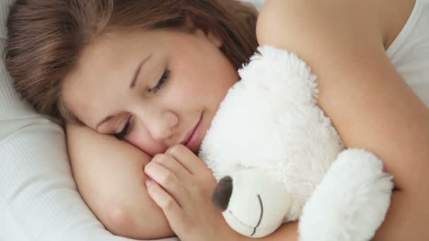 sleeping girl hugging teddy bear